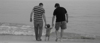 Image - two parents with baby on beach