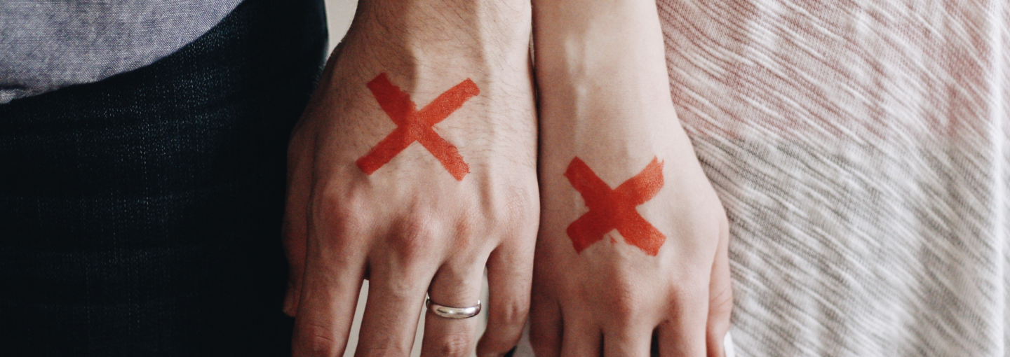 Image - man and woman hands marked with X