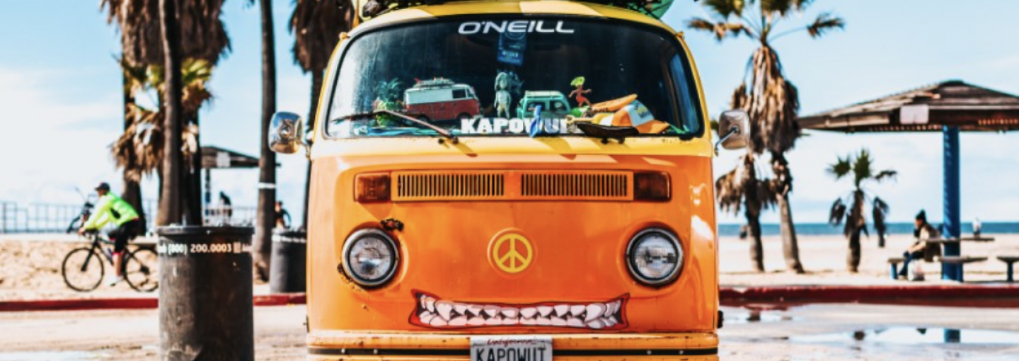 Image - VW van with surfboards on top