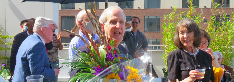 Image - George Dobbins holding flowers