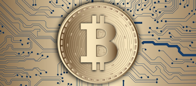 Image - Bitcoin symbol in front of computer circuitry