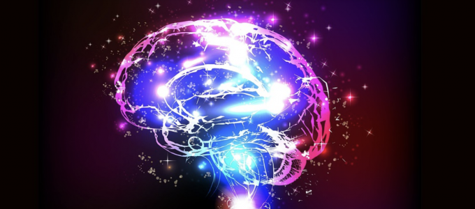 Image - illustration of human brain bathed in multi-colored lights