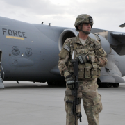 Image - U.S. soldier in front of Air Force plane in Afghanistan